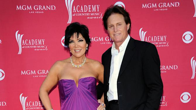 FILE - This April 5, 2009 file photo shows Kris Jenner, left, and her husband Bruce Jenner at the 44th Annual Academy of Country Music Awards in Las Vegas. Kris Jenner filed for divorce Monday, Sept. 22, 2014, in Los Angeles, from estranged husband, Bruce Jenner, citing irreconcilable differences. (AP Photo/Dan Steinberg, File)