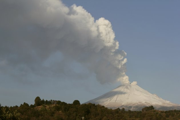 The Popocatepetl volcano spews a cloud of ash and steam high into the air, as seen from San Nicolas de los Ranchos, on the outskirts of Puebla