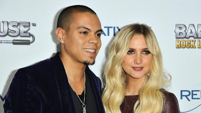 """FILE - This Nov. 12, 2013 file photo shows Evan Ross, left, and Ashlee Simpson at the """"Bandfuse: Rock Legends"""" video game launch in Los Angeles. Simpson is engaged to boyfriend Evan Ross, who is the son of Diana Ross. The pair announced the news on Twitter Monday, Jan. 13, 2014, confirmed Simpson's publicist Janet Ringwood. Simpson was previously married to Fall Out Boy bassist Pete Wentz. They have a five-year-old son named Bronx. Ross is an actor who will appear in the final two installments of """"The Hunger Games."""" (Photo by Richard Shotwell/Invision/AP, File)"""