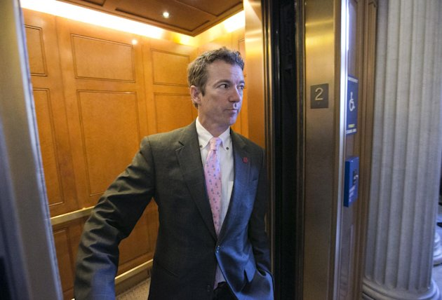 Sen. Rand Paul, R-Ky. is questioned by reporters in an elevator as he leaves a GOP policy meeting on Capitol Hill in Washington, Thursday, March 7, 2013. Call it Rand's Stand: a nearly 13-hour filibus