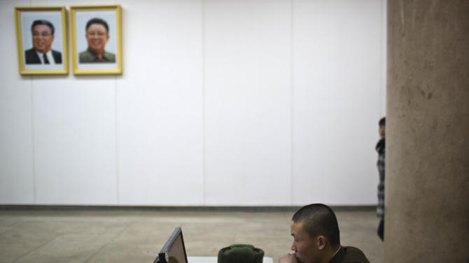 A North Korean soldier works at a computer terminal under portraits of the the late leaders Kim Il Sung and Kim Jong Il inside the Grand People's Study House in Pyongyang on Tuesday, March 12, 2013. (AP Photo/David Guttenfelder)