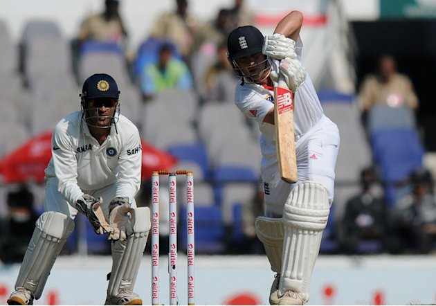 MS Dhoni watches as Jonathan Trott drives on Day 1 of the fourth cricket Test match between India and England at the Jamtha Stadium in Nagpur, December 13, 2012. (BCCI)