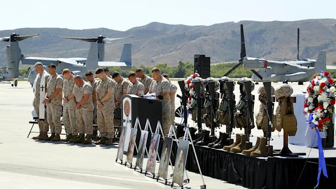 A moment of silence is given to marines from the 3rd Marine Aircraft Wing during a memorial service at Camp Pendleton