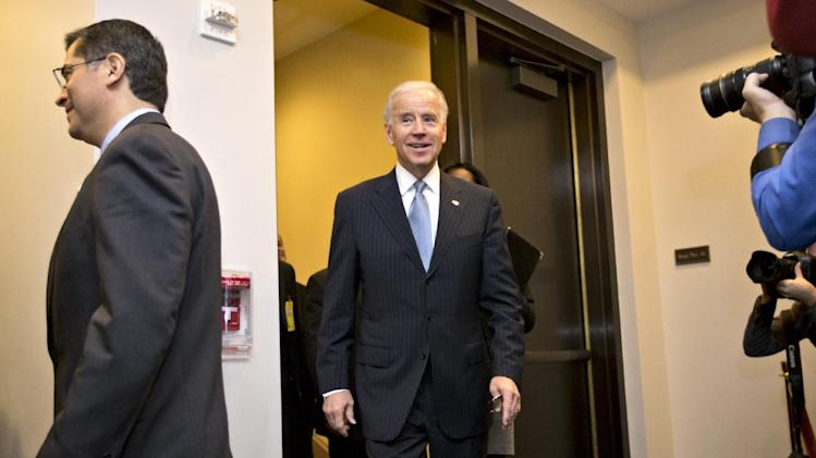 Vice President Joe Biden arrives for a closed-door meeting with House Democrats, on Capitol Hill in Washington, Tuesday, Jan. 1, 2013, to discuss the fiscal cliff bill passed by the Senate last night that's waiting for a vote in the Republican-controlled House. At left is Rep. Xavier Becerra, D-Calif. Biden who has been shuttling between the White House and Capitol Hill to help negotiate a legislative path to avert the across-the-board tax increases and sweeping spending cuts that could damage the economy. (AP Photo/J. Scott Applewhite)