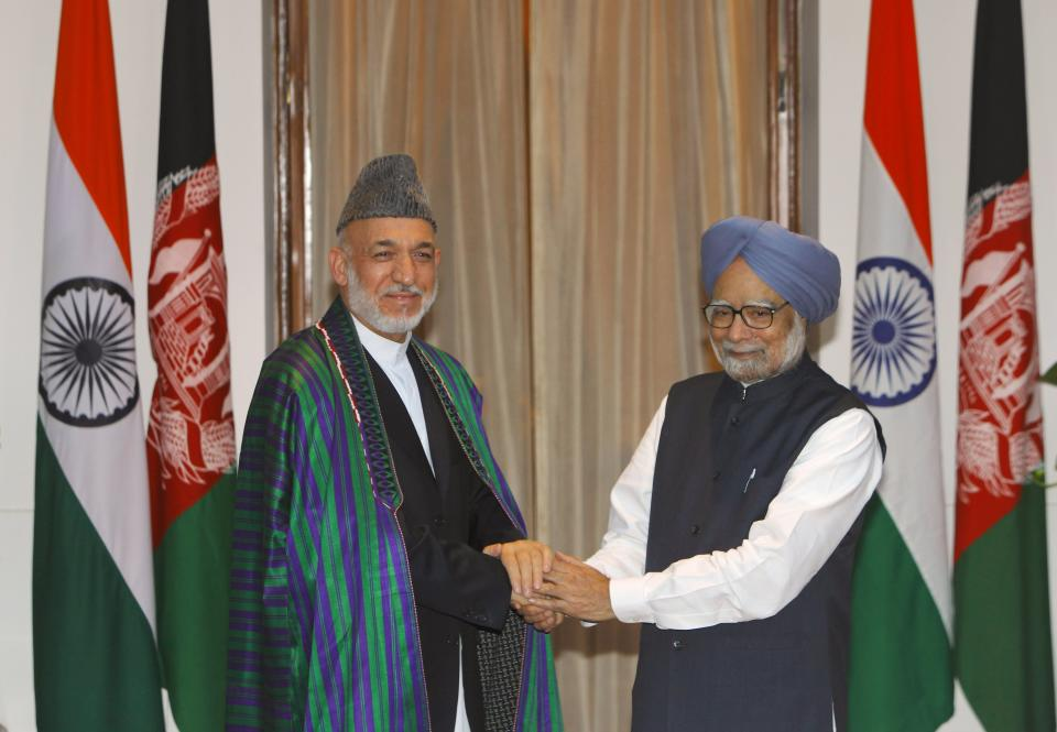 Indian Prime Minister Manmohan Singh, right, and Afghanistan President Hamid Karzai pose before a meeting in New Delhi, India, Tuesday, Oct. 4, 2011.  Karzai is on a two-day official visit to India.(AP Photo/Gurinder Osan)