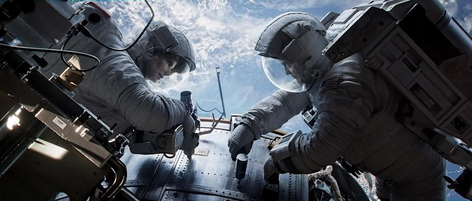 "This publicity photo released by Courtesy of Warner Bros. Pictures shows Sandra Bullock, left, as Dr. Ryan Stone and George Clooney as Matt Kowalsky in Warner Bros. Pictures' sci-fi thriller ""Gravity,"" a Warner Bros. Pictures release. (AP Photo/Courtesy Warner Bros. Pictures)"