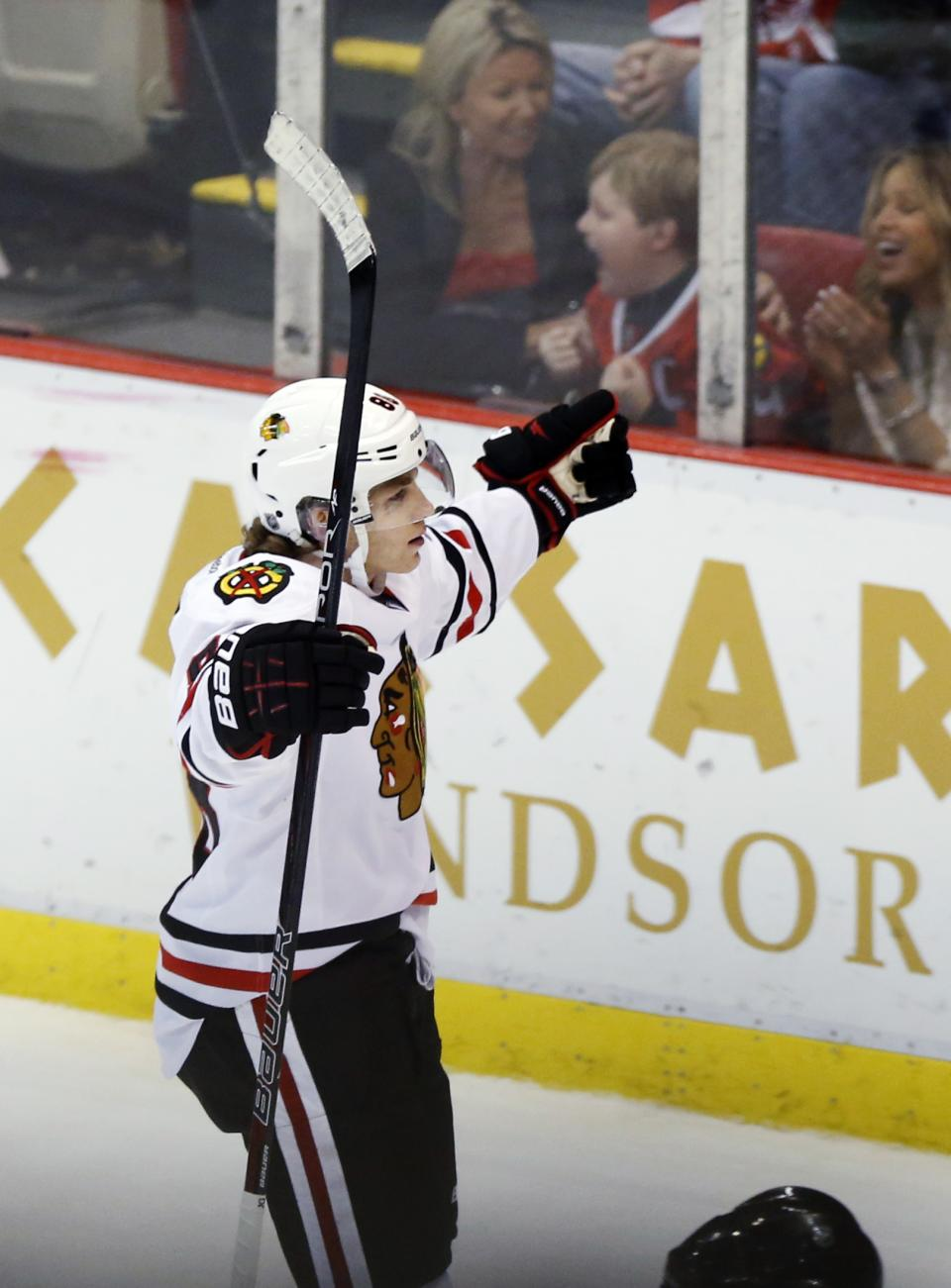 Chicago Blackhawks right wing Patrick Kane celebrates his shootout goal to defeat the Detroit Red Wings 2-1 in an NHL hockey game, Sunday, March 3, 2013, in Detroit. (AP Photo/Duane Burleson)