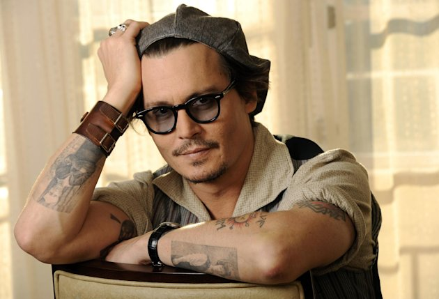 "FILE - In this Oct. 12, 2011 file photo, Johnny Depp, a cast member in the film ""The Rum Diary,"" poses for a portrait in Beverly Hills, Calif. In San Diego, fans at Comic-Con on Thursday, July 12, 2012, got the first look at ""The Lone Ranger,"" which stars Depp, set for release next summer. (AP Photo/Chris Pizzello, File)"