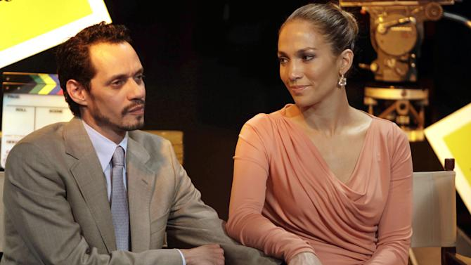 FILE - In this March 4, 2011 file photo, Jennifer Lopez, right, and husband Marc Anthony attend a signing ceremony for filmmaking incentive legislation for the U.S. island territory in Bayamon, Puerto Rico. A Los Angeles judge finalized Lopez and Anthony's divorce on Monday, June 16, 2014, nearly three years after the couple separated in July 2011. (AP Photo/Ricardo Arduengo, file)