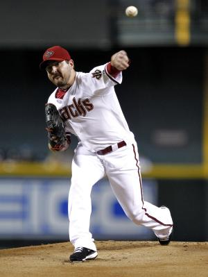 Arizona Diamondbacks pitcher Joe Saunders delivers against the Miami Marlins during the first inning of a baseball game, Monday, Aug. 20, 2012, in Phoenix. (AP Photo/Matt York)