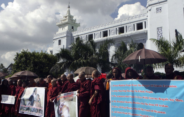 Myanmar Buddhist monks hold banners and placards during a rally against recent violence in Rakhine state, outside the city hall in Yangon, Myanmar, Thursday, Oct. 25, 2012. Nearly 200 protesters including Buddhist monks called for the stop of renewed violence in western coast of Myanmar. Rakhine state spokesman Myo Thant said clashes between Rohingya Muslims and ethnic Rakhine Buddhists - reported in other parts of the coastal region Sunday - engulfed the townships of Kyaukphyu and Myebon late Tuesday. (AP Photo)