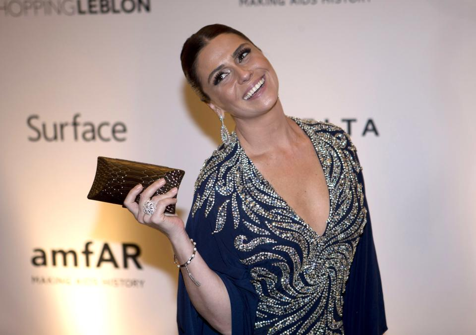 Brazilian actress Giovanna Antonelli poses for photographers as she arrives to a charity dinner for amfAR, a foundation for AIDS research in Rio de Janeiro, Brazil, Friday, Oct. 4, 2013. (AP Photo/Silvia Izquierdo)