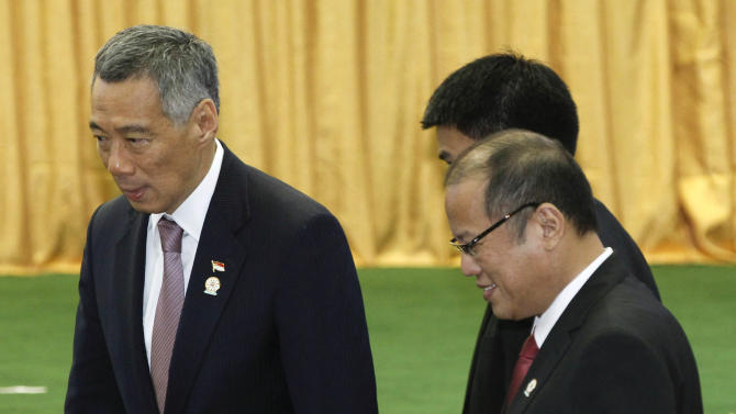 Philippines' President Benigno Aquino III, right, walks next to Singapore's Prime Minister Lee Hsien Loong, after the opening ceremony for the 21st Association of Southeast Asian Nations or ASEAN Summit in Phnom Penh, Cambodia, Sunday, Nov. 18, 2012. (AP Photo/Vincent Thian)
