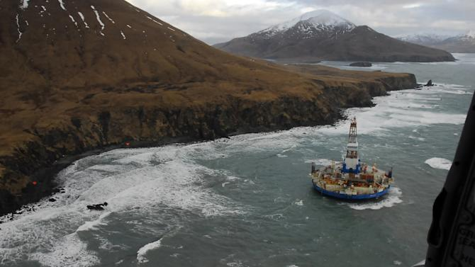 In this image provided by the U.S. Coast Guard the conical drilling unit Kulluk sits grounded near a beach 40 miles southwest of Kodiak City, Alaska, Thursday, Jan. 3, 2012. The Kulluk grounded after many efforts by tug vessel crews and Coast Guard crews to move the vessel to safe harbor during a winter storm. (AP Photo/U.S. Coast Guard, Petty Officer 2nd Class Zachary Painter)