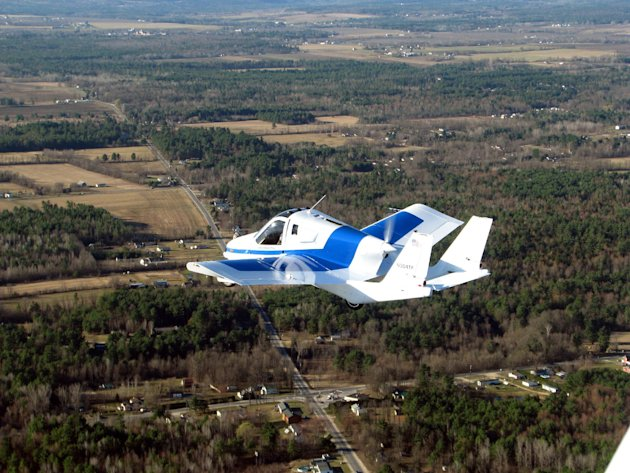 This March 23, 2012 photo provided by Terrafugia Inc. shows the company's prototype flying car, dubbed the Transition, during its first flight. The vehicle has two seats, four wheels and wings that fo