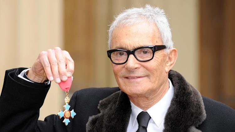 FILE - An Oct. 20, 2009 photo from files showing Vidal Sassoon after he received his Commander of the British Empire medal (CBE) from Queen Elizabeth II at an Investiture ceremony at Buckingham Place, London. Sassoon, whose 1960s wash-and-wear cuts freed women from endless teasing and hairspray died Wednesday, May 9, 2012, at his home. He was 84. )AP Photo/PA, Anthony Devlin, File) UNITED KINGDOM OUT  NO SALES  NO ARCHIVE