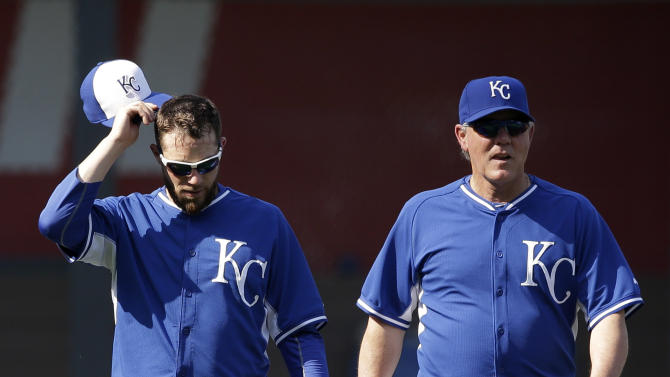 Kansas City Royals relief pitcher Greg Holland, left, walks with manager Ned Yost, right, before a baseball game against the Minnesota Twins at Kauffman Stadium in Kansas City, Mo., Friday, July 3, 2015. (AP Photo/Orlin Wagner)
