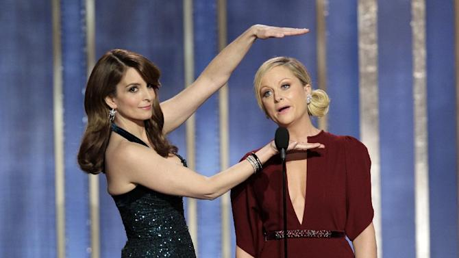 This image released by NBC shows co-hosts Tina Fey, left, and Amy Poehler on stage during the 70th Annual Golden Globe Awards held at the Beverly Hilton Hotel on Sunday, Jan. 13, 2013, in Beverly Hills, Calif. (AP Photo/NBC, Paul Drinkwater)