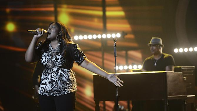 "This publicity photo released by Fox shows Candice Glover, left, performing on ""American Idol,""  Wednesday, May 8 (8:00-10:00 PM ET/PT) on Fox.The current 12th season is set to conclude Thursday, May 16, 2013, with a showdown between the 23-year-old R&B vocalist Glover of St. Helena Island, S.C., and the 22-year-old country crooner Kree Harrison of Woodville, Texas. (AP Photo/Fox, Michael Becker)"