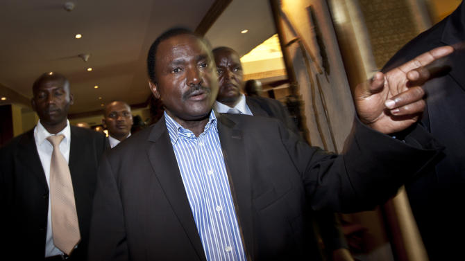 """Kalonzo Musyoka, center, Kenya's current Vice President and running mate of presidential candidate Raila Odinga, gestures as he leaves after speaking at a press conference in Nairobi, Kenya Thursday, March 7, 2013. The coalition of Kenya's prime minister Raila Odinga says the vote tallying process now under way to determine the winner of the country's presidential election """"lacks integrity"""", should be stopped, and the counting process should be restarted using primary documents from polling stations. (AP Photo/Ben Curtis)"""