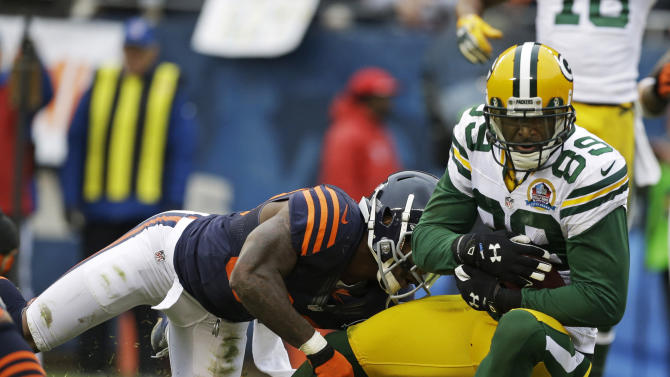 Green Bay Packers wide receiver James Jones (89) crosses the goal line with a touchdown reception while tackled by Chicago Bears cornerback D.J. Moore in the first half of an NFL football game in Chicago, Sunday, Dec. 16, 2012. (AP Photo/Nam Y. Huh)