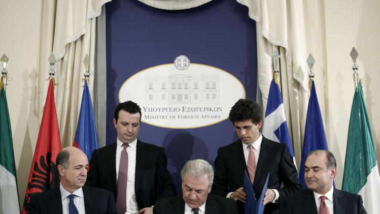 Greek Foreign Minister Dimitris Avramopoulos, front center, Albanian Finance and Energy Minister Edmond Haxhinasto, front right, and Italian Development Minister Corrado Passera during a signing ceremony backing the privately-funded venture known as the Trans-Adriatic Pipeline, worth euro 1.5 billion ($2.02 billion), in Athens, on Wednesday, Feb. 13, 2013. Greece, Italy and Albania signed an agreement backing a proposed pipeline to transport natural gas from the Caspian Sea to western Europe. (AP Photo/Petros Giannakouris)