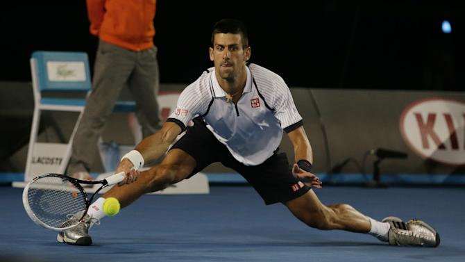 Serbia's Novak Djokovic hits a forehand return to Tomas Berdych of the Czech Republic during their quarterfinal match at the Australian Open tennis championship in Melbourne, Australia, Tuesday, Jan. 22, 2013. (AP Photo/Aaron Favila)