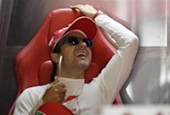 Ferrari Formula One driver Felipe Massa of Brazil laughs during the third practice session of the Italian F1 Grand Prix at the Monza circuit September 7, 2013. REUTERS/Max Rossi/Files