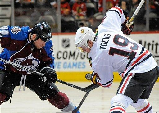 Emery, Kane lead Blackhawks to 5-2 win over Avs