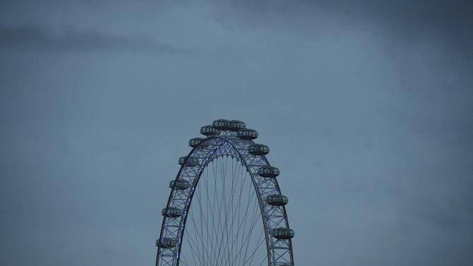 The London Eye is seen at dawn in central London
