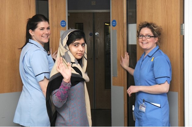 This photo made available by Queen Elizabeth Hospital, Birmingham, England shows Malala Yousufzai saying goodbye as she is discharged from the hospital to continue her rehabilitation at her family's t