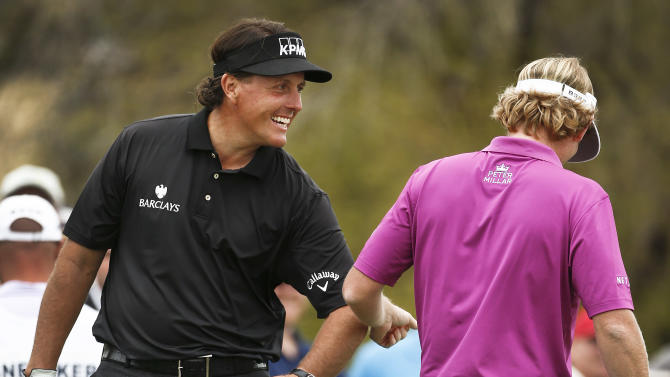 Phil Mickelson, left, smiles as he bumps elbows with Brandt Snedeker after both make birdie on the seventh hole during the final round of the Waste Management Phoenix Open golf tournament on Sunday, Feb. 3, 2013, in Scottsdale, Ariz. (AP Photo/Ross D. Franklin)