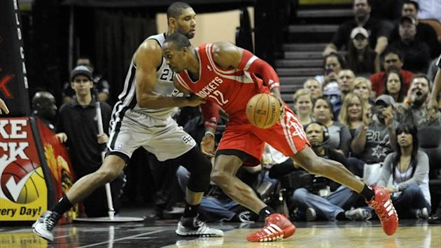 ouston Rockets forward Dwight Howard (12) drives against San Antonio Spurs forward Tim Duncan (21) Brendan Maloney-USA TODAY Sports (Reuters)
