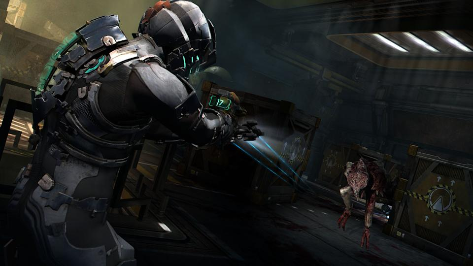 "In this publicity image released by Electronic Arts, Isaac Clarke fires at a necromorph in a scene from the sci-fi horror action game ""Dead Space 2."" (AP Photo/Electronic Arts)"