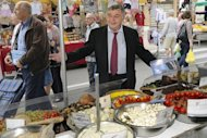 Roland Chassain, right-wing UMP candidate for Bouches-du-Rhone campaigns in a market in Saint-Martin-de-Crau, southern France