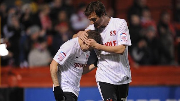 Leyton Orient's Dean Cox (left) celebrates scoring his teams fourth goal of the game with teammate David Mooney (right)
