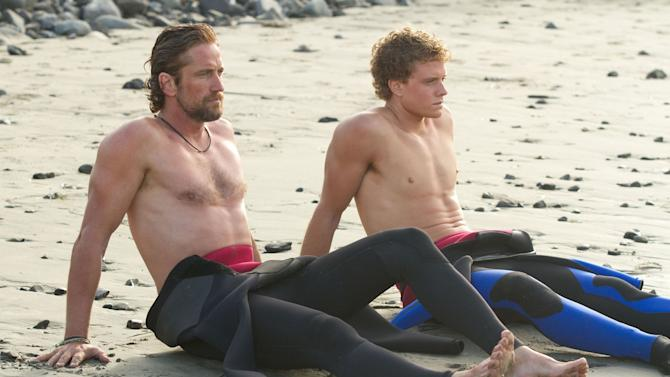 "This film image released by Twentieth Century Fox shows Gerard Butler, left, and Jonny Weston in a scene from ""Chasing Mavericks.""   (AP Photo/Twentieth Century Fox, John P. Johnson)"