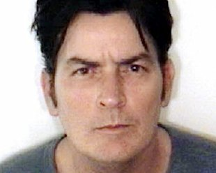 A mugshot of Charlie Sheen, from the night he spent in jail last year. (via NY Daily News)