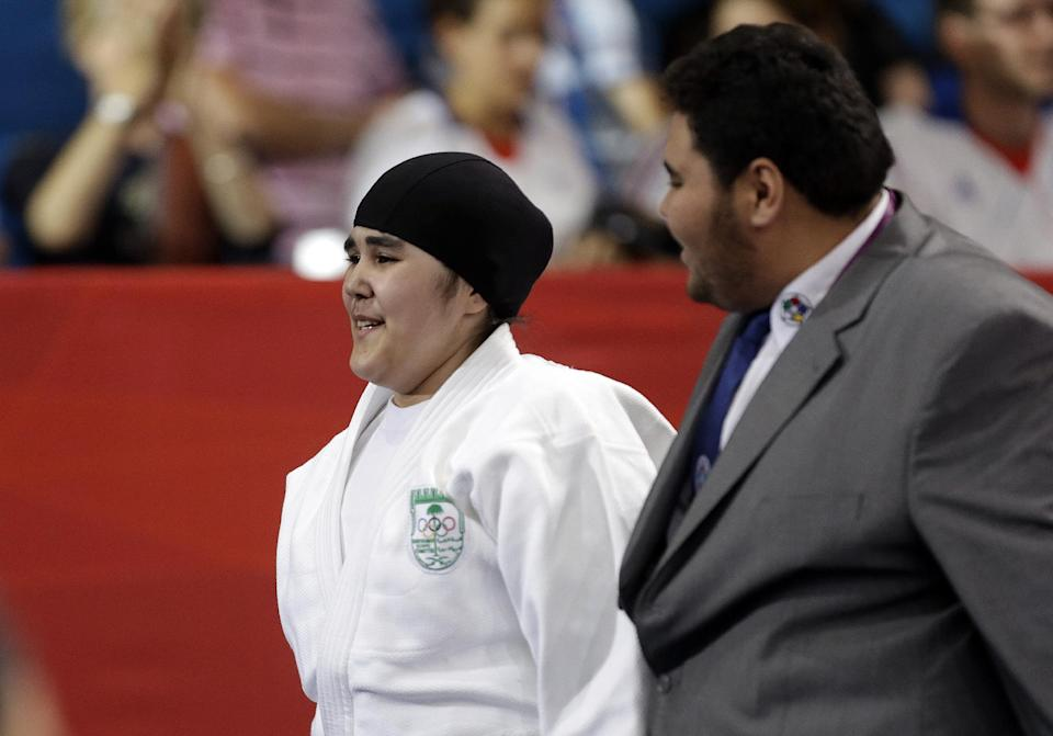 Saudi Arabia's Wojdan Shahrkani reacts after the women's 78-kg judo competition against Puerto Rico's Melissa Mojica at the 2012 Summer Olympics, Friday, Aug. 3, 2012, in London. (AP Photo/Paul Sancya)