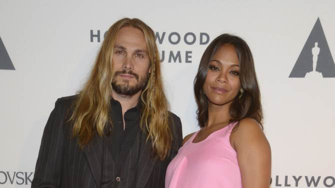 Zoe Saldana and Marco Perego attend the opening of Hollywood Costume in Los Angeles