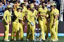 Australia's paceman Mitchell Starc (2-R) celebrates his first wicket of New Zealand's Brendon McCullum with teammates during the World Cup final between Australia and New Zealand in Melbourne on March 29, 2015