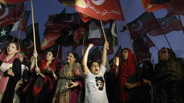 Supporters of Pakistan's cricketer turned-politician Imran Khan rally in Karachi, Pakistan, Thursday, Aug. 21, 2014. Thousands of Khan's supporters are besieging parliament in the capital for a second day Thursday to pressure Prime Minister Nawaz Sharif to resign over alleged election fraud. (AP Photo/Fareed Khan)
