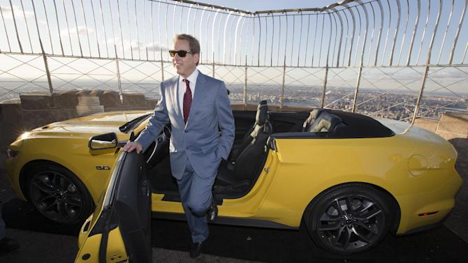 Bill Ford, Ford Motor Company's executive chairman, stands with the all-new 2015 Mustang convertible as it's introduced on the 86th floor observation deck of the Empire State Building during the New York International Auto Show, Wednesday, April 16, 2014, in New York. (AP Photo/John Minchillo)