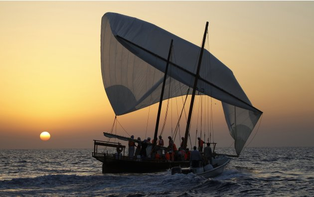 A team sails a traditional wooden boat, or a dhow, before the start of the Al Gaffal race, near Sir Bu Nuayr Island in the United Arab Emirates