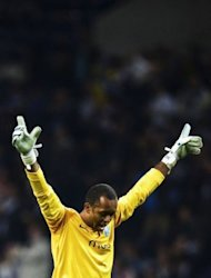 FC Porto's Brazilian goalkeeper Helton celebrates his team's first score against Dynamo Kiev during the UEFA Champions league football match Porto vs Dynamo Kiev at the Dragao stadium in Porto. Porto won 3-2