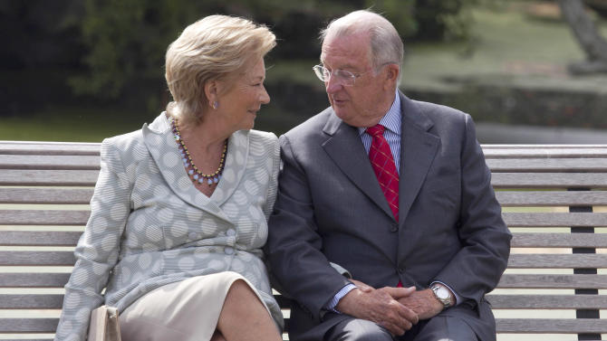 FILE - In this Sunday, Sept. 2, 2012 file photo, Belgium's King Albert II, right, speaks with Queen Paola as they sit on a bench on the grounds of the Royal Palace in Laeken, Belgium. Belgian King Albert has unexpectedly announced that he will address the nation Wednesday July 3, 2013, a speech that comes amid rumors he will step down in the near future. The Royal Palace announced Albert will first attend a meeting with key government members before the address to air on all major broadcast networks at 6pm (1600GMT; Noon EST). (AP Photo/Virginia Mayo, File)
