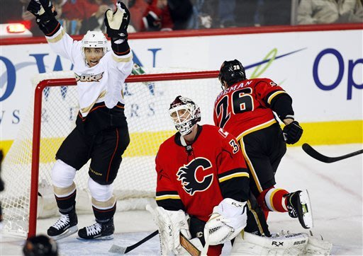 Anaheim Ducks' Andrew Cogliano, left, celebrates the team's third goal as Calgary Flames goalie Miikka Kiprusoff, of Finland, reacts during the first period of their NHL hockey game, Monday, Jan. 21, 2013, in Calgary, Alberta. (AP Photo/The Canadian Press, Jeff McIntosh)