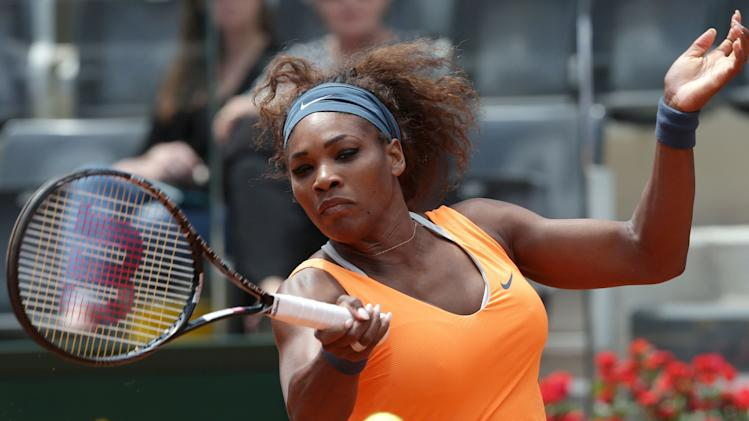 Serena Williams, of the United States, returns the ball to Spain's Carla Suarez Navarro during their match at the Italian Open tennis tournament in Rome, Friday, May 17, 2013. (AP Photo/Riccardo De Luca)