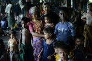 Muslim Rohingyas at a school sheltering Internally Displaced Persons in the village of Theik Kayk Pyim, located on the outskirts of Sittwe, capital of Myanmar's western Rakhine state. Between late 2011 and May this year, an estimated 7,000 to 8,000 Rohingya left Rakhine or Bangladesh by boat for Malaysia