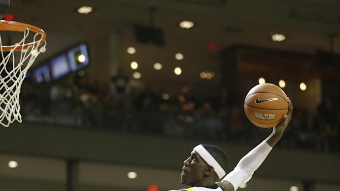 Virginia Commonwealth guard Briante Weber (2) launches to the basket for a dunk after a steal during the first half of an NCAA college basketball game against Butler in Richmond, Va., Saturday, March 2, 2013.   (AP Photo/Steve Helber)